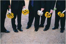 jason keefer photography keswick vineyards wedding charlottesville virginia sunflowers groomsmen holding bouquet