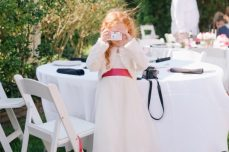 outer banks destination wedding photographer jason keefer photography flower girl taking picture